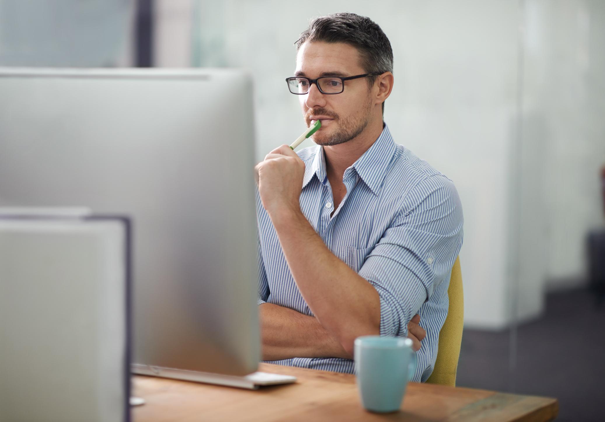 Man looking at computer screen